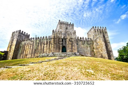 The Castle of Guimaraes is the principal medieval castle in the municipality Guimaraes, Portugal - stock photo
