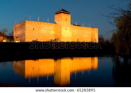 The castle of Gyula after sunset in twilight - stock photo
