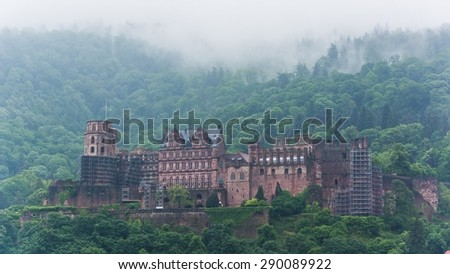 the castle of heidelberg in fog - stock photo