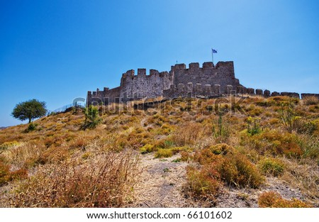 the castle on the hill overlooking the greek island town of Molyvos
