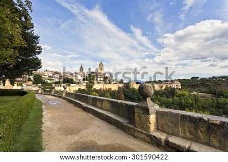 The cathedral and the old citadel seen from the garden of the El Alcazar castle in Segovia, Spain  - stock photo