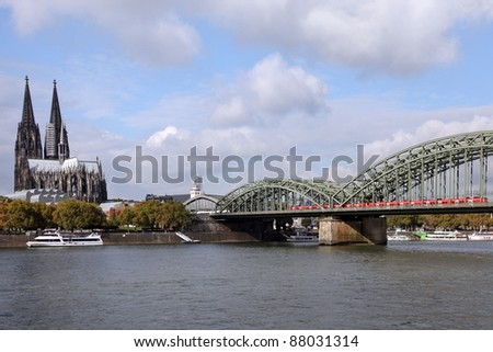 the Cathedral of Cologne and the Rhine River with Hohenzollern bridge - stock photo