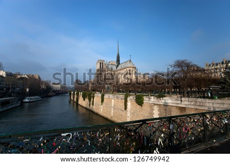 The Cathedral of Notre Dame of Paris in an Autumn morning - stock photo