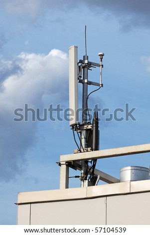 The cellular communication aerial on a building roof - stock photo
