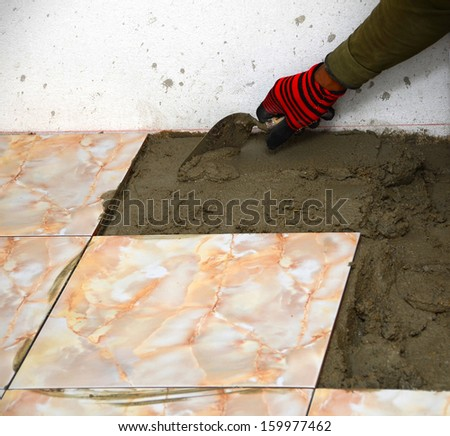 The cement mortar before laying tile, building construction. - stock photo