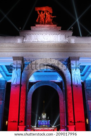 The central gate of All Russian Exhibition center in festive lighting, Moscow, Russia - stock photo