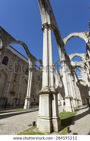 The central nave of the Convento do Carmo in Lisbon. This large cathedral built by the Carmelite order and was destroyed during the Lisbon earthquake of 1755 leaving only the bare arches and walls.  - stock photo