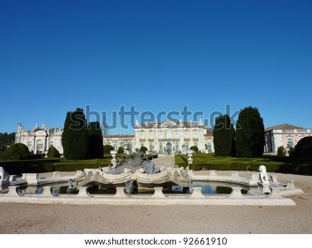 The ceremonial facade of the corps de logis of the Queluz national palace in Portugal with bronze statues in a fountain in front - stock photo