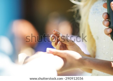 The ceremony of putting a ring on the hand of the groom