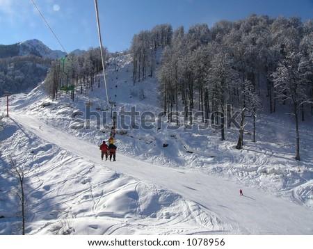 the chairlift in a Krasnaya Polyana. Sochi, Black Sea, Russia. - stock photo