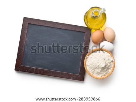 the chalkboard and ingredients for preparing pasta - stock photo