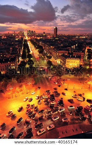The Champs Elysees, Etoile Charles De Gaulle and La Defense at sunset - stock photo