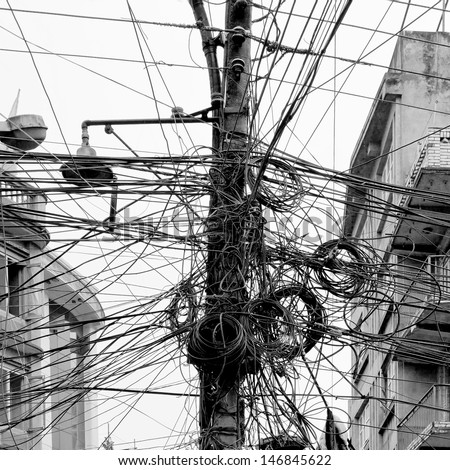The chaos of cables and wires in Kathmandu - Nepal (black and white) - stock photo