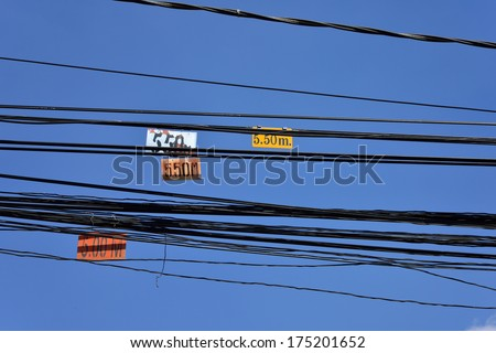 The chaos of cables and wires in urban - stock photo