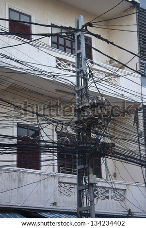 The chaos of cables and wires in Vientiane, Laos. - stock photo