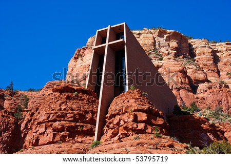 The Chapel of the Holy Cross is an iconic Catholic chapel built into the mesas of Sedona, Arizona.  It is built directly into a butte and offers a spectacular view of the valley below. - stock photo