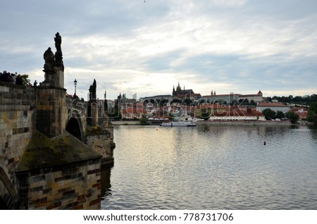 The Charles Bridge, the Vltava river and the historic city of Prague