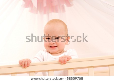 The charming kid  in a children's room