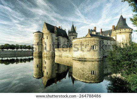 The chateau of Sully-sur-Loire in the evening, France. This castle is located in the Loire Valley, dates from the 14th century and is a prime example of medieval fortress. - stock photo