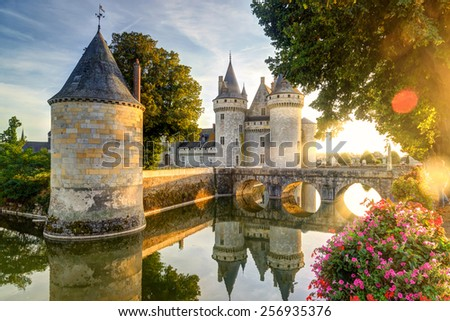 The chateau of Sully-sur-Loire in the sunlight with lens flare, France. This castle is located in the Loire Valley, dates from the 14th century and is a prime example of medieval fortress. - stock photo