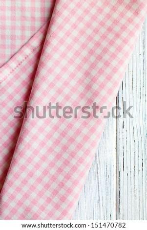 the checkered napkin on white wooden table - stock photo