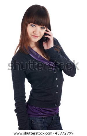 The cheerful charming brunette female with phone  isolated on white - stock photo