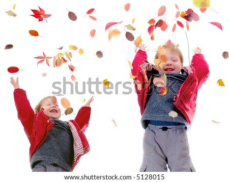 The cheerful little boy throws autumn leaves on a white background - stock photo