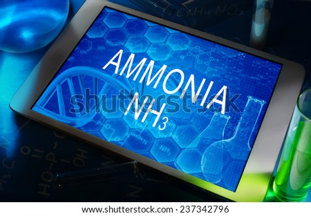 the chemical formula of Ammonia on a tablet with test tubes   - stock photo