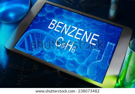 the chemical formula of Benzene on a tablet with test tubes   - stock photo