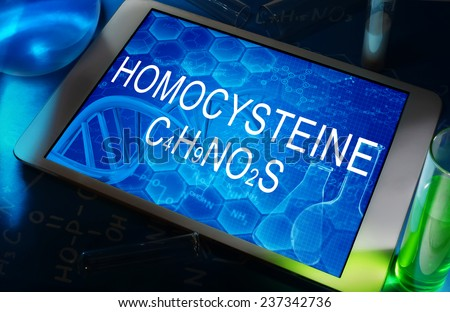 the chemical formula of Homocysteine on a tablet with test tubes   - stock photo