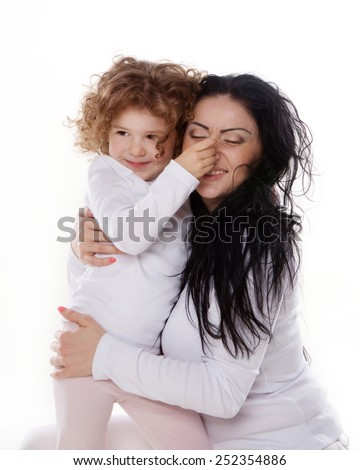 The child and mother holding nose each other isolated on the white background - stock photo