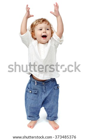 The child dances on a white background, indulge in, runs, plays, hands up - stock photo