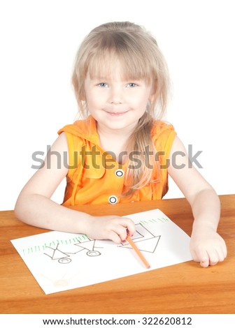 The child draws at the table. WHITE BACKGROUND. - stock photo