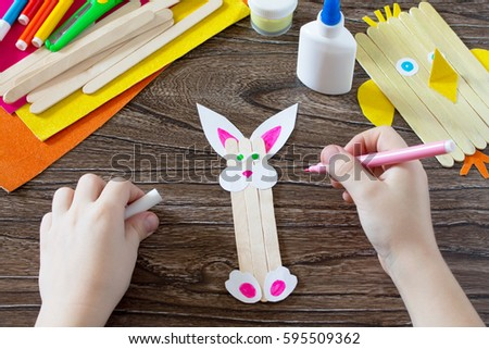 Childrens easter gift wooden chopsticks toy stock photo 595509287 the child draws details of gift items childrens easter gift toy chicken and easter bunny negle Gallery