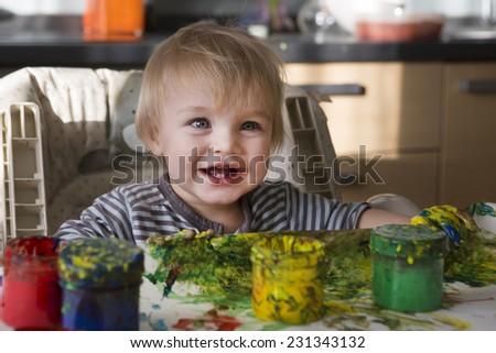 the child draws paints - stock photo