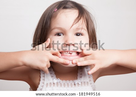 The child dropped the first milk tooth - stock photo