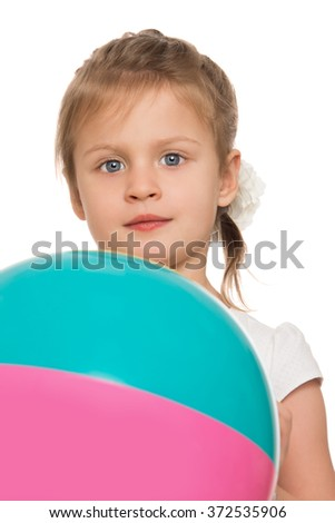 The child holds the ball - stock photo