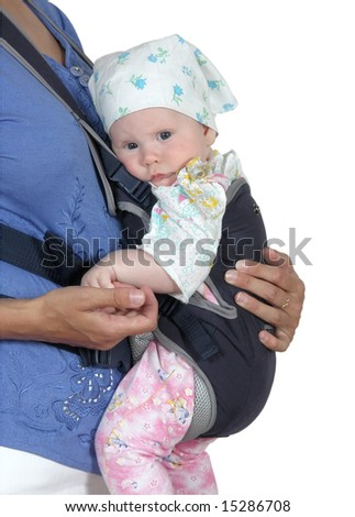 The child in a backpack on a breast of mother