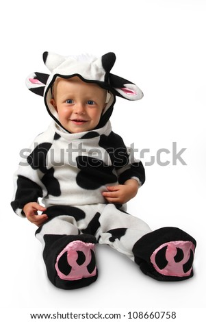 The child in a costume of a cow on a white background