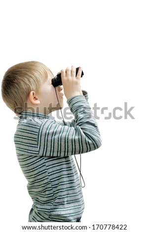 The child looks in the field-glass - stock photo