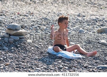 The child on the sea coast - stock photo