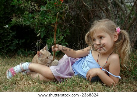 the child play with kitten - stock photo