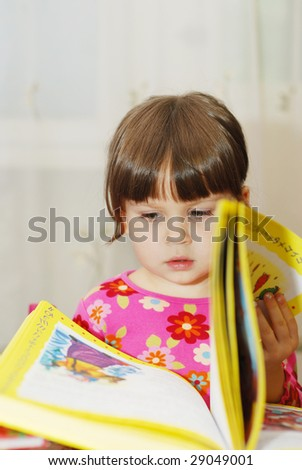 The child reading the book - stock photo