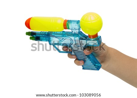 The child's hand with a water pistol isolated on white background - stock photo