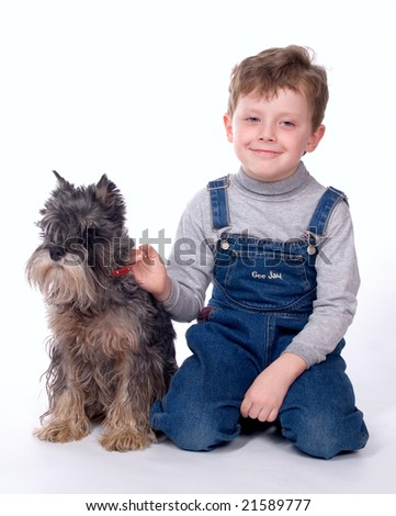 The child sits with a dog on a white background - stock photo
