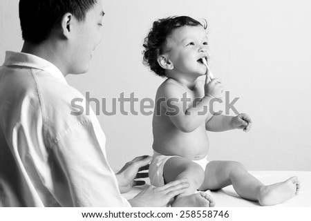 The child studies to clean a teeth - stock photo