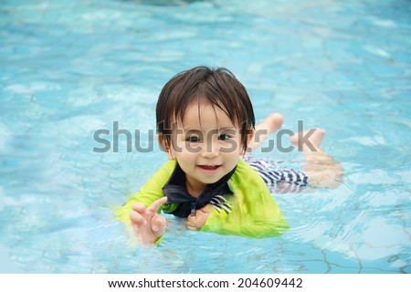 The child who plays a pool - stock photo