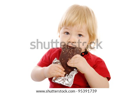 The child with a chocolate bar in a hand. On a white background - stock photo