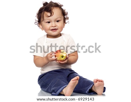 The child with an apple in a hand, on a white background. - stock photo