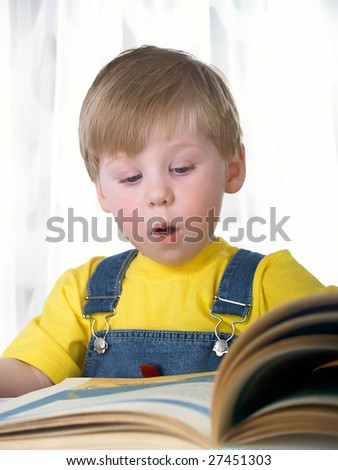 The child with books on the white background - stock photo